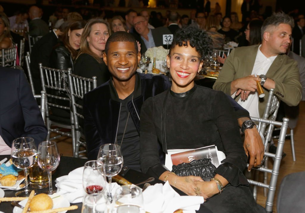 Singer-songwriter Usher Raymond IV (L) and Grace Miguel at the 2017 Make a Wish Gala  | Photo: Getty Images
