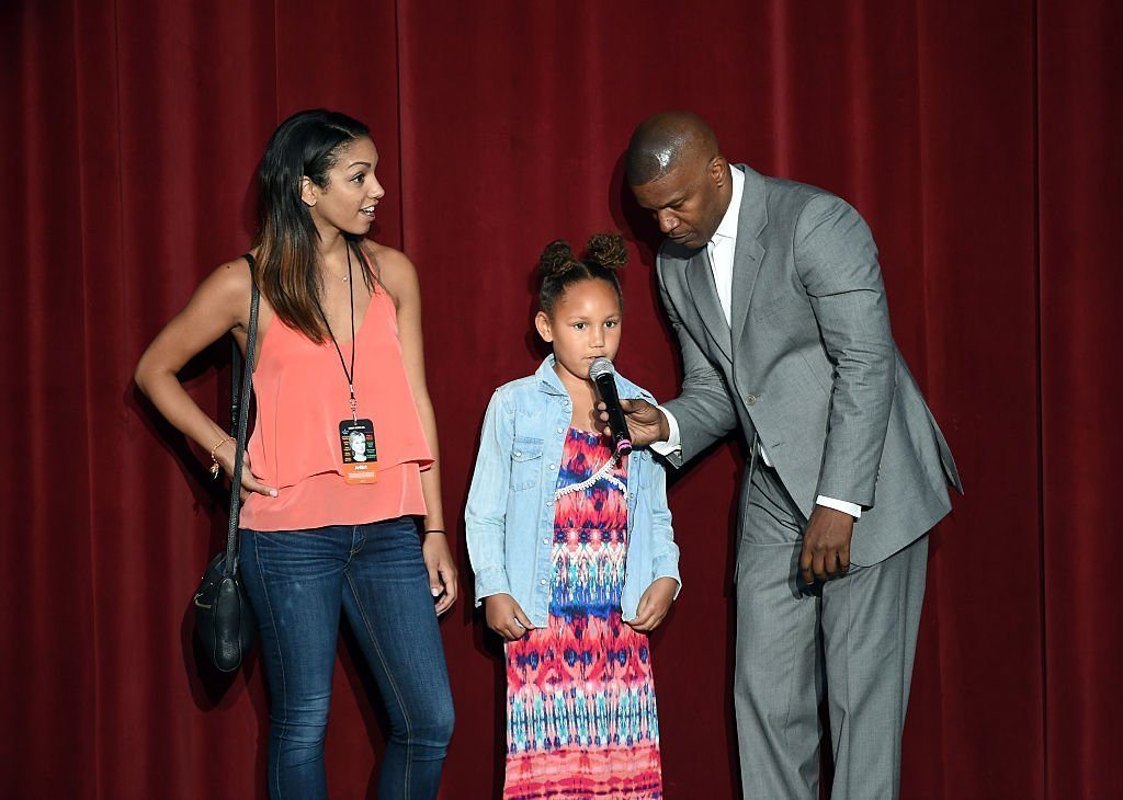 "Jamie Foxx with daughters Corinne (L) & Annalise (C) during the ""Hillary Clinton: She's With Us"" concert on June 6, 2016 in California 