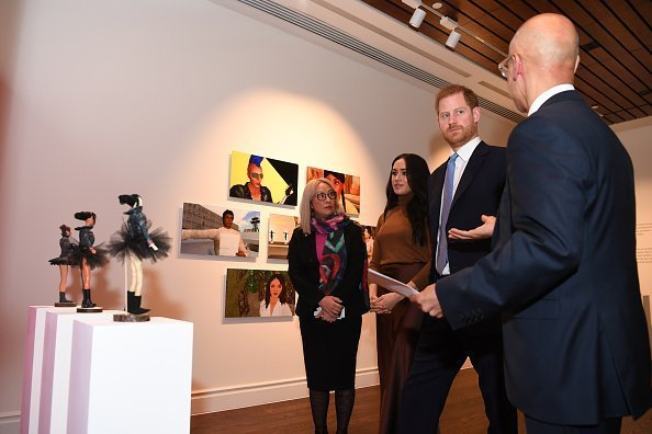 Prince Harry, Duke of Sussex and Meghan, Duchess of Sussex view a special exhibition of art by Indigenous Canadian artist, Skawennati, in the Canada Gallery during their visit to Canada House | Photo: Getty Images