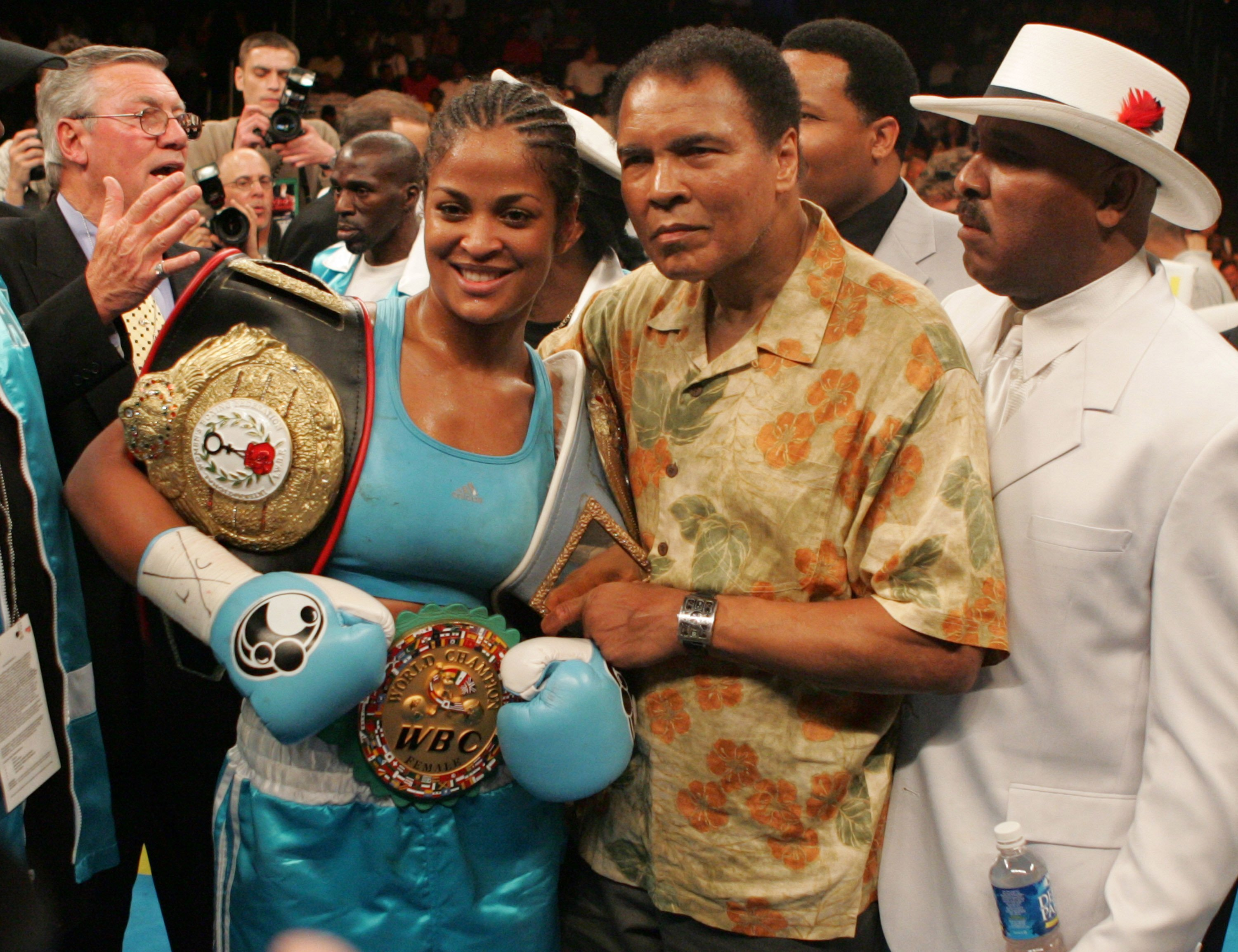 Laila Ali and her father, Muhammad Ali after her 10-round WBC/WBA Super Middleweight title win against Erin Toughill in June 2005. | Photo: Getty Images