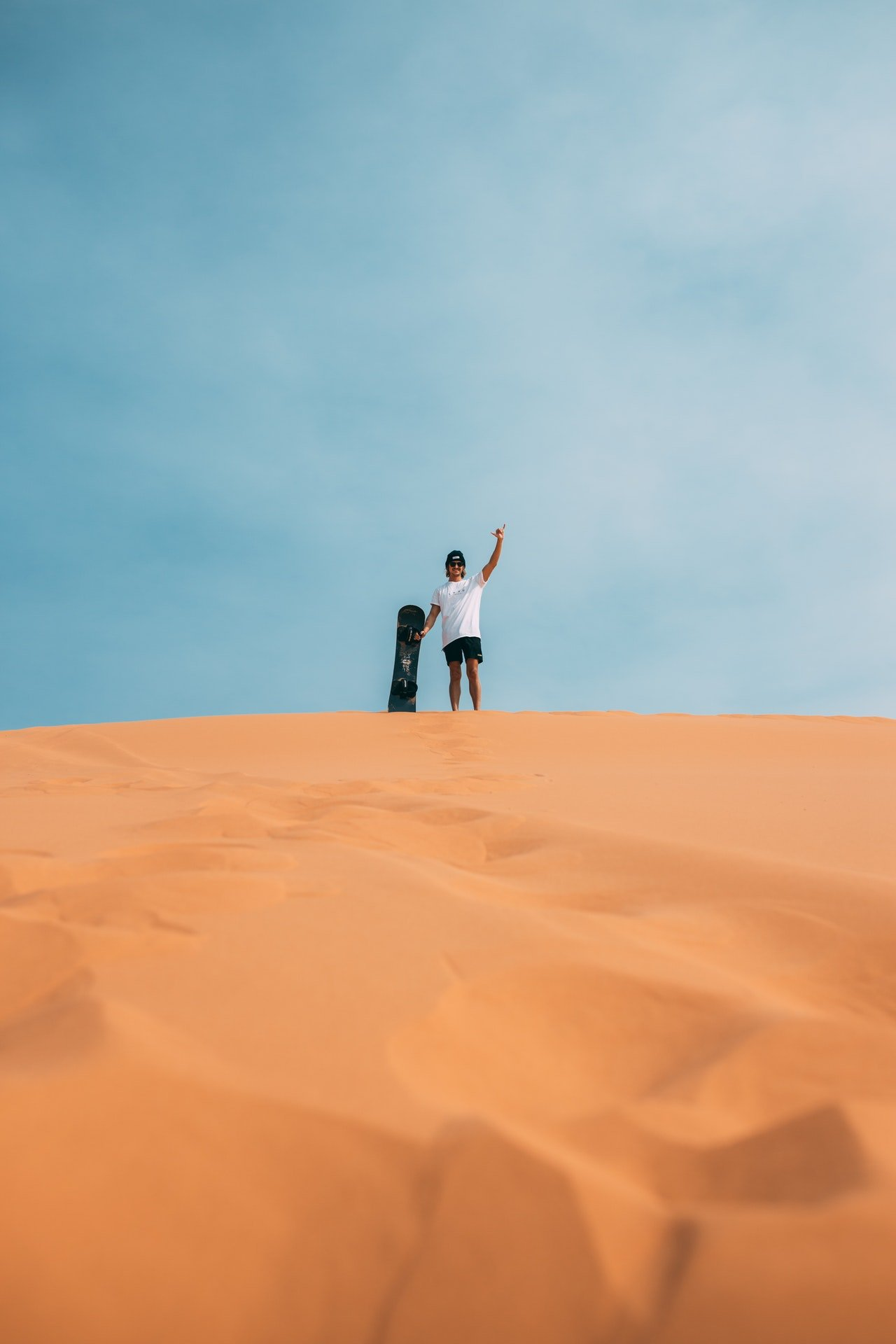 Photo of a man in a desert   Photo: Pexels