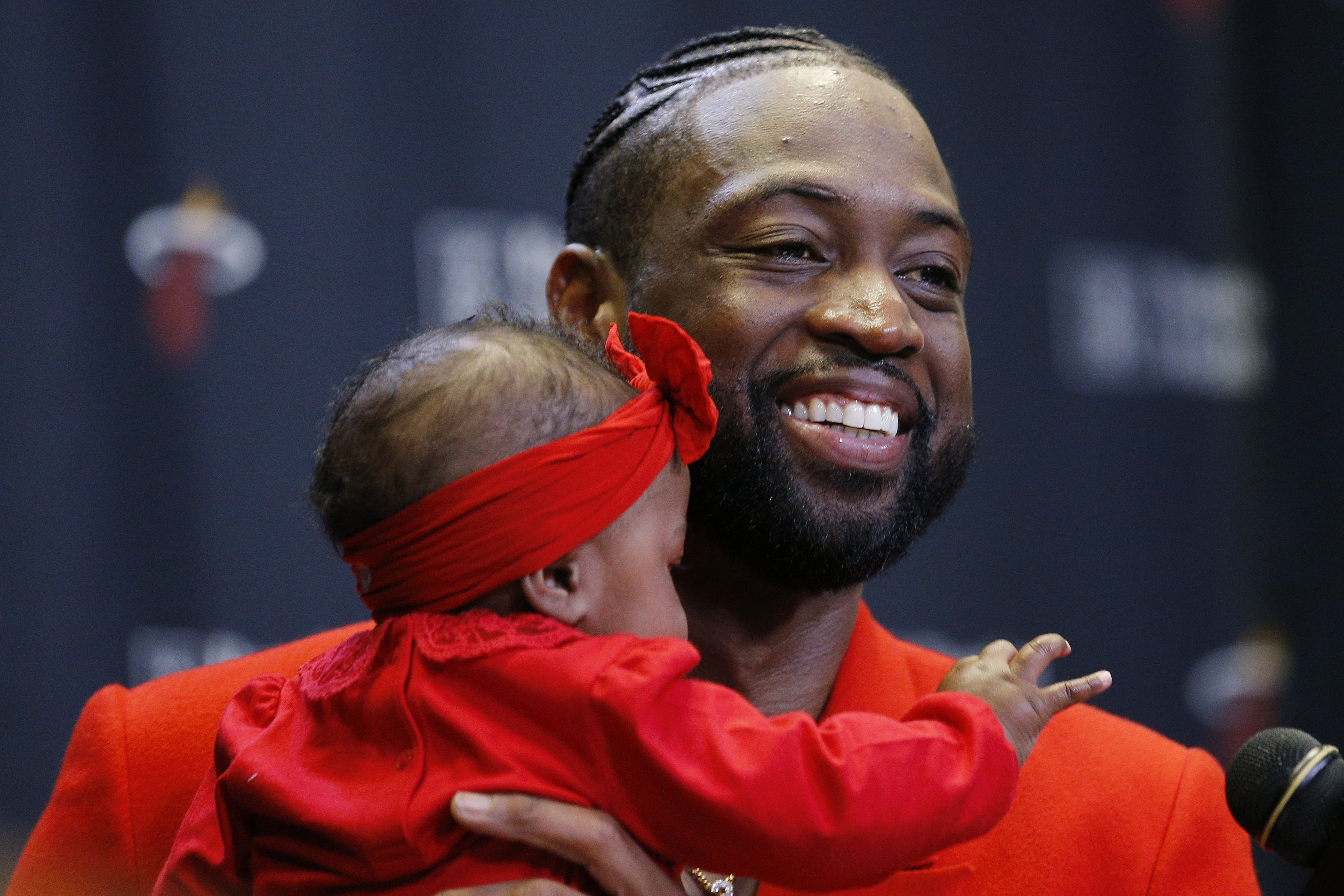 : Dwyane Wade #3 of the Miami Heat addresses the media after his final regular season home game at American Airlines Arena with his daughter, Kaavia James Union Wade, on April 09, 2019 in Miami, Florida. | Getty Images : pgotos
