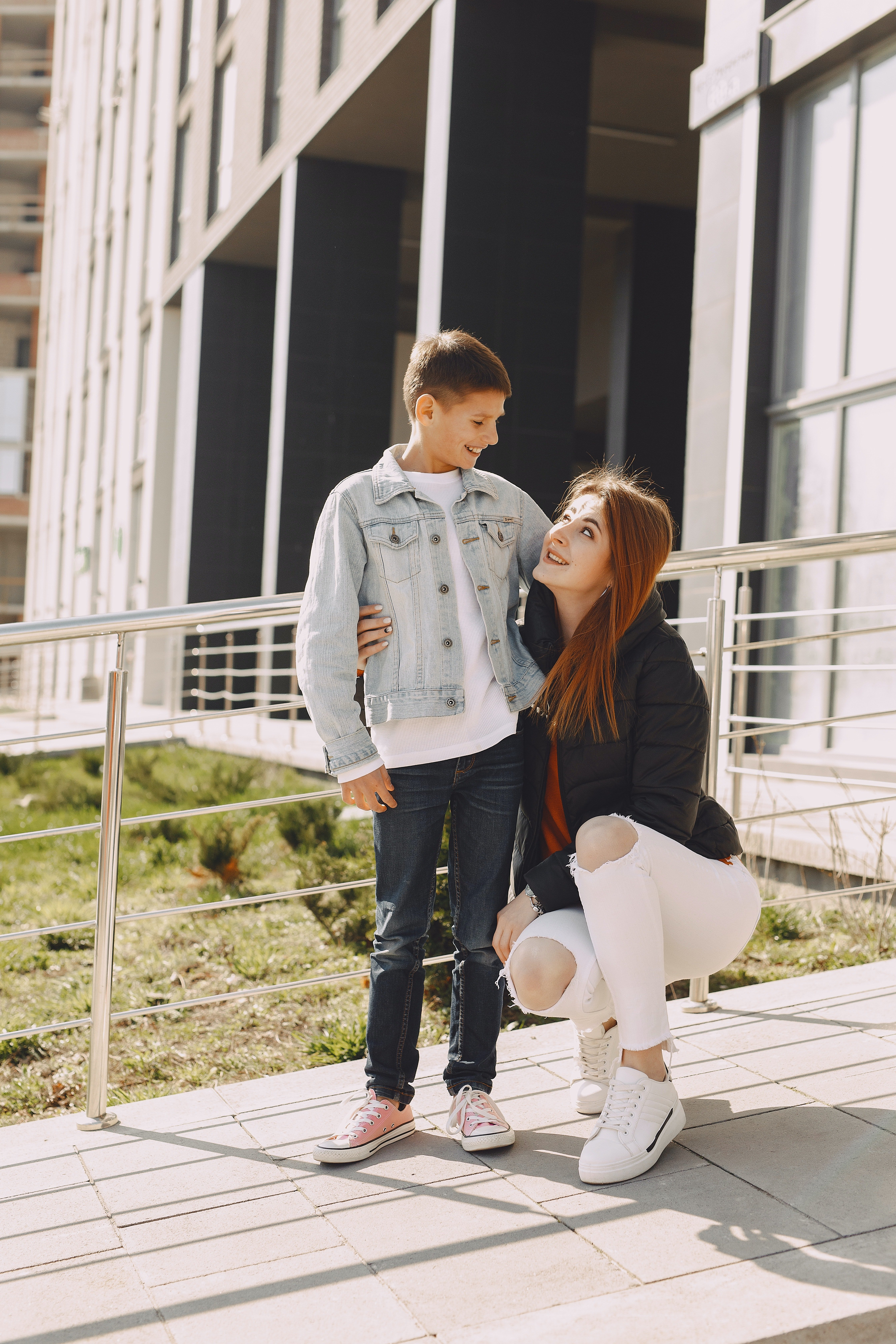 Happy mother and son hugging on street   Photo: Pexels