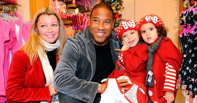 Former footballer John Barnes, with wife Andrea and daughters Isabella and Tia, who joined patients from Great Ormond Street Hospital at the Disney store in Oxford Street, London on November 4, 2009 | Photo: Getty Images