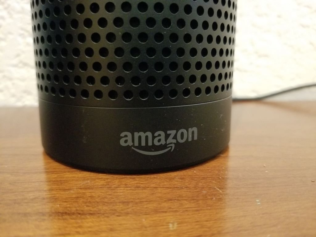 Close-up of the base of an Amazon Echo smart speaker using the Alexa service, with Amazon logo visible. | Photo: Getty Images