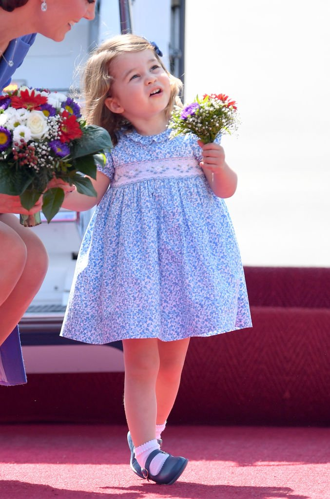 Princess Charlotte arrives at Berlin's Tegel Airport during an official visit to Poland and Germany on July 19, 2017 in Berlin, Germany. | Photo: Getty Images
