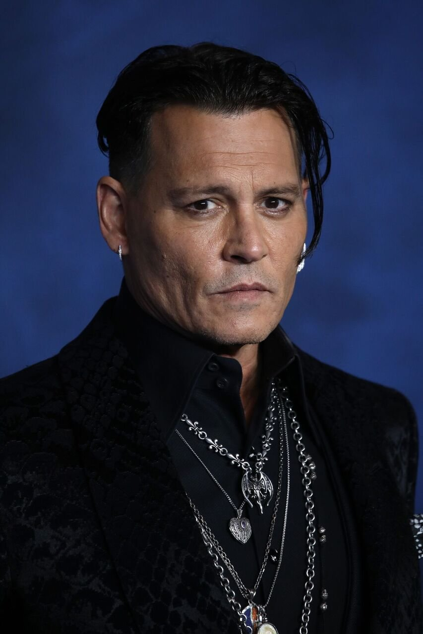 "Johnny Depp attends the UK Premiere of ""Fantastic Beasts: The Crimes Of Grindelwald."" 