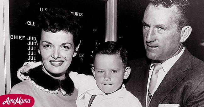 Jane Russell and her husband, Bob Waterfield, pose with their adopted son, Tommy. | Photo: Getty Images