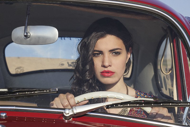 A woman driving alone in a car.   Photo: Flickr