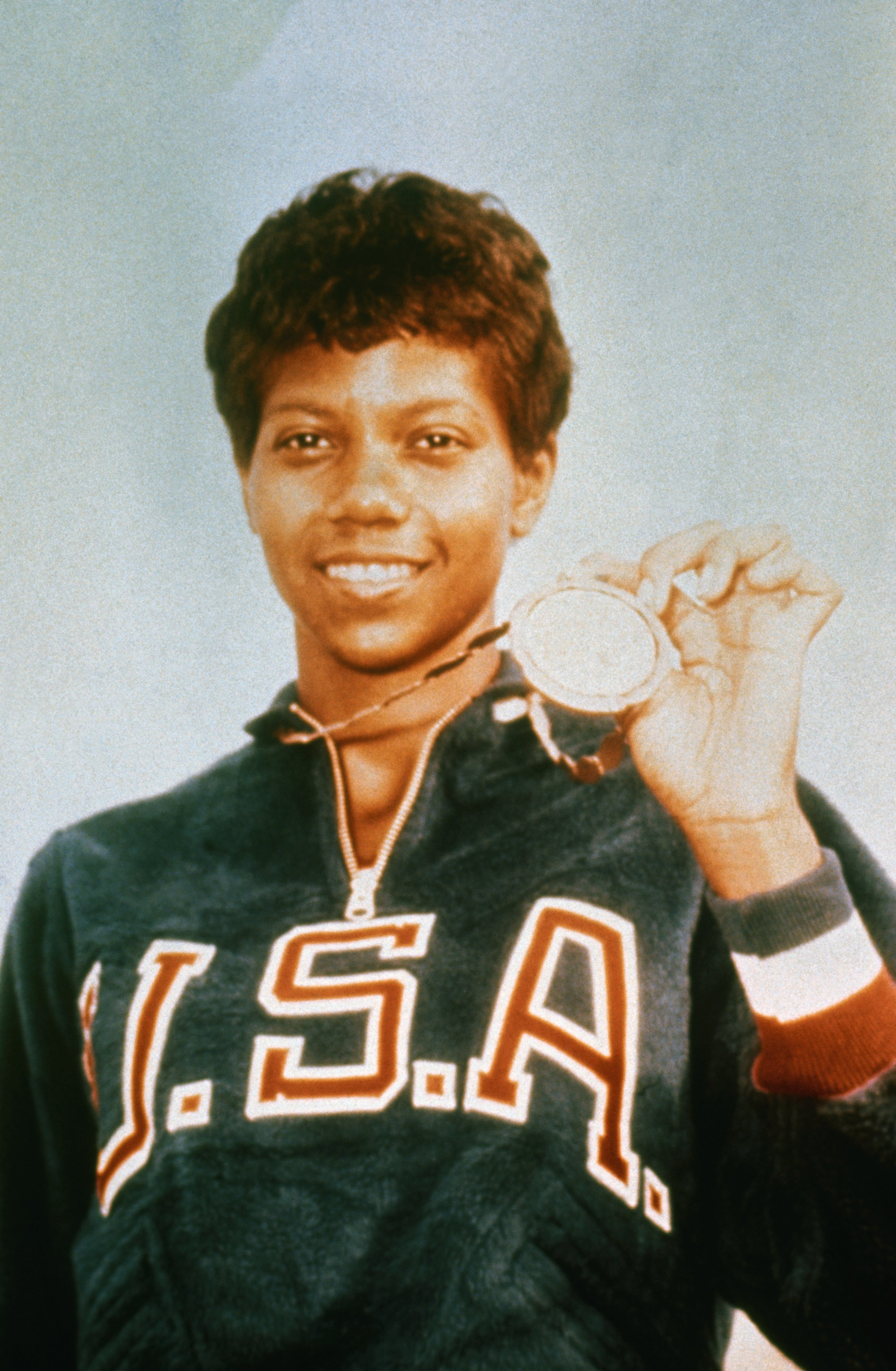 Wilma Rudolph with the gold medal she won for the 200-meter dash at the 1960 Olympics in Rome   Photo: Getty Images