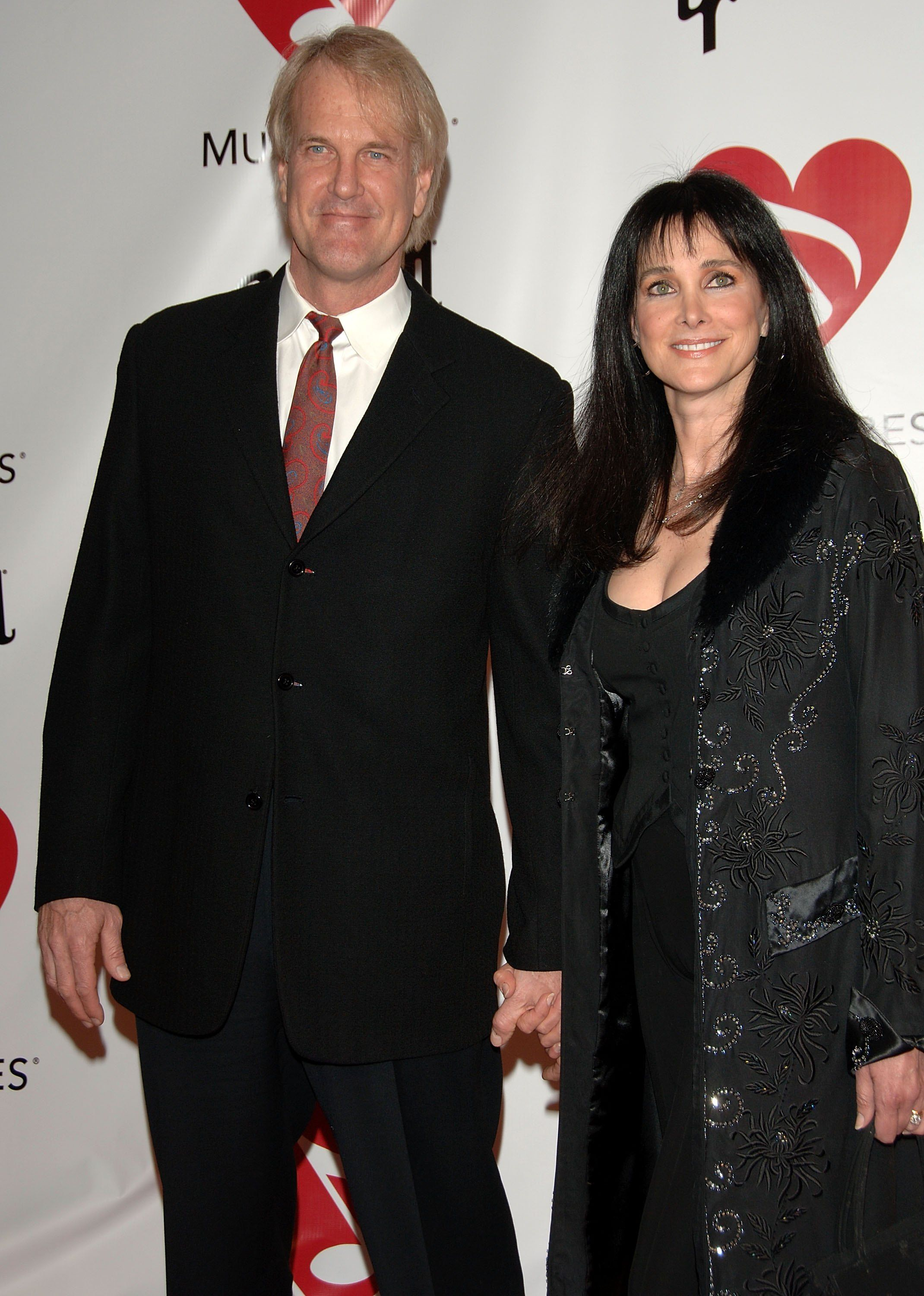 John Tesh and Connie Sellecca during 2006 MusiCares Person of the Year Tribute to James Taylor | Source: Getty Images