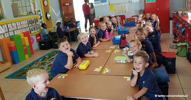 Black and white children sit at different tables in classroom picture from South African school