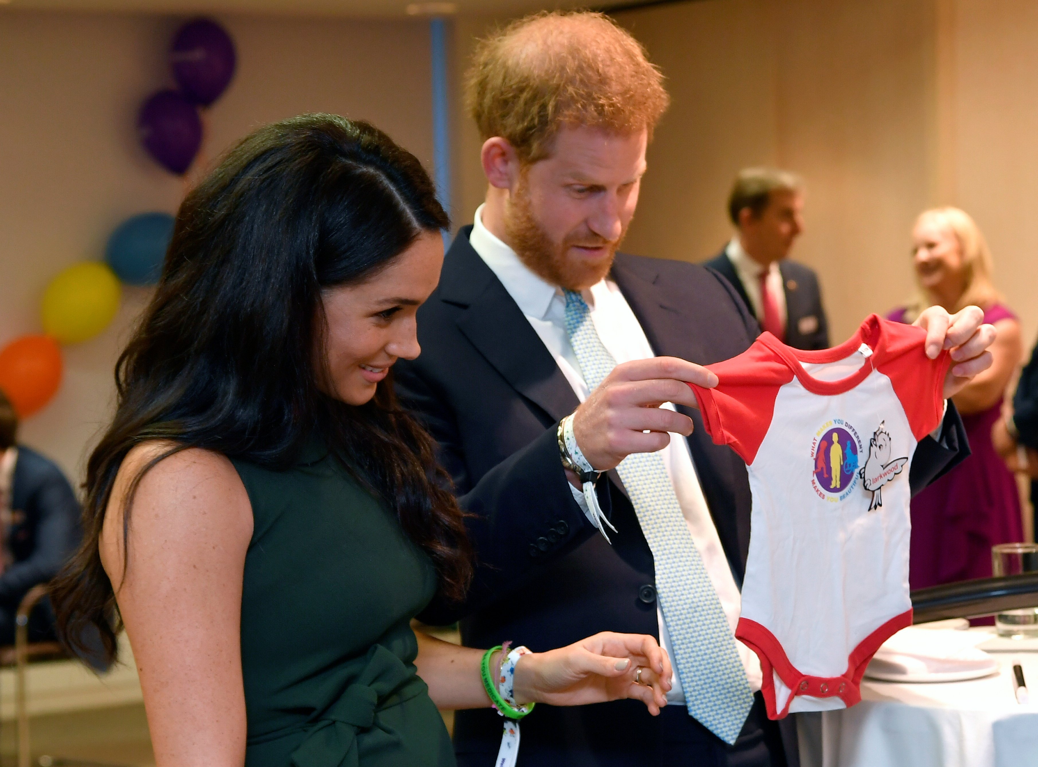 """The Duke and Duchess of Sussex receive a gift for Archie at """"The Child Awards"""" in London, October, 2015. 