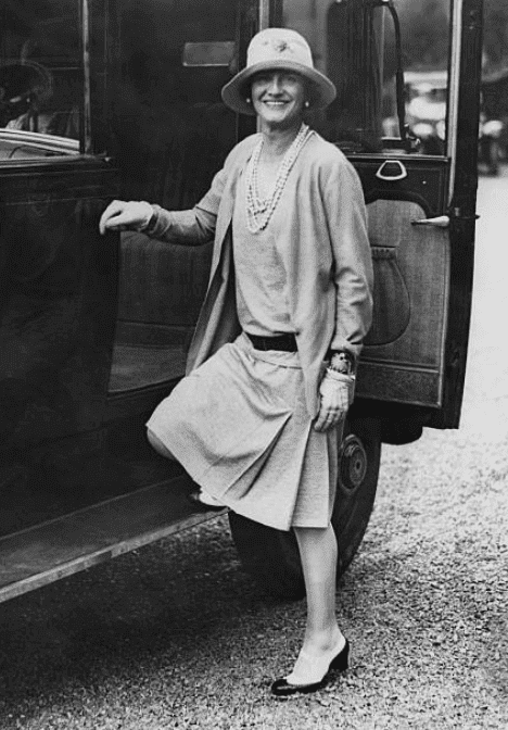 French fashion designer, Coco Chanel getting into a car in 1928, while visiting the resort town of Biarritz, France | Source: Getty Images
