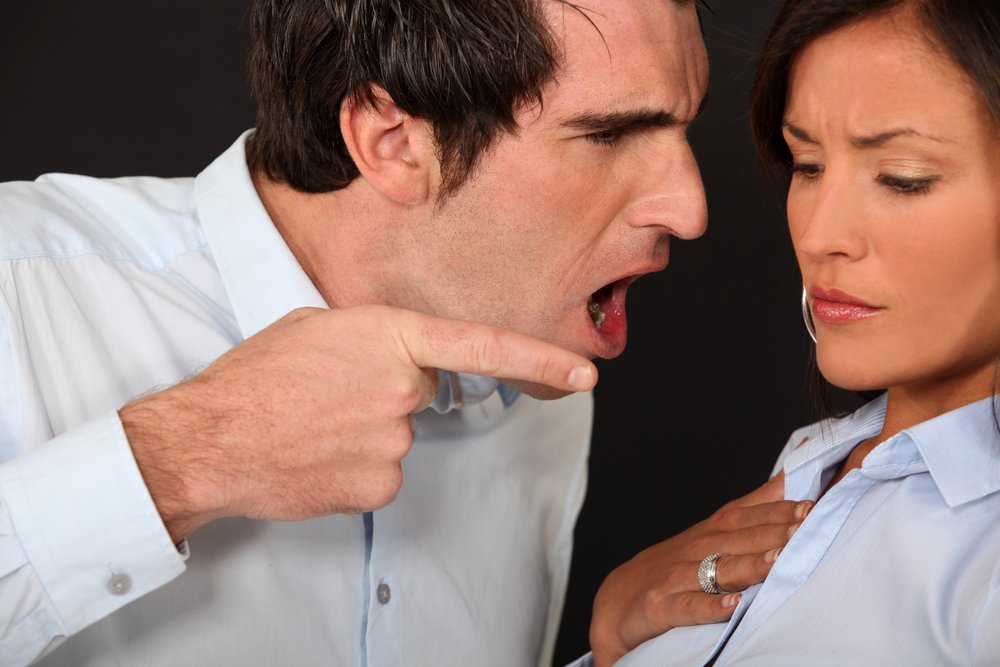 A man gets in a woman's face, points at her with a finger, and shouts angrily | Photo: Shutterstock/Phovoir