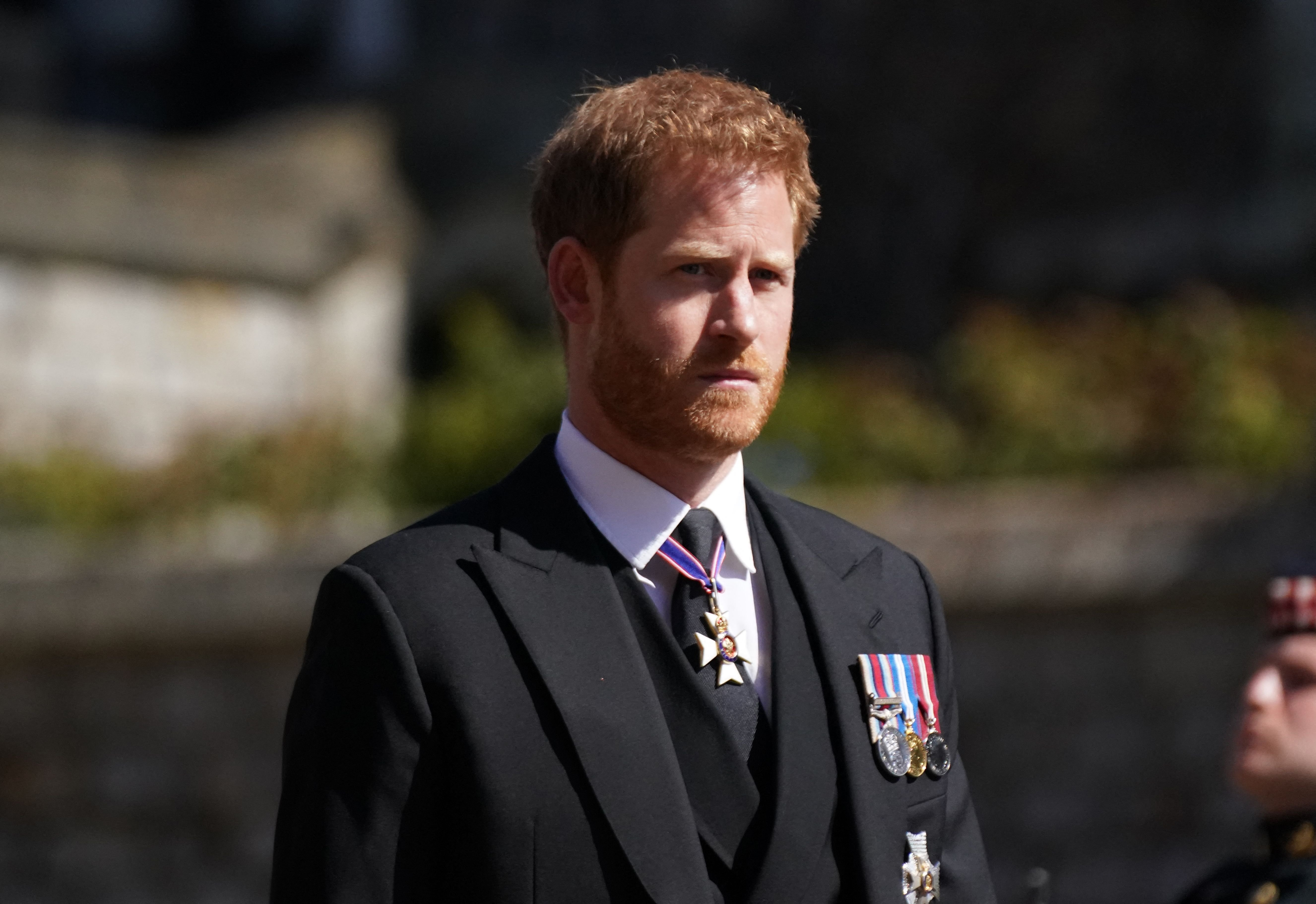 Britain's Prince Harry, Duke of Sussex walks during the funeral procession of Britain's Prince Philip, Duke of Edinburgh to St George's Chapel in Windsor Castle in Windsor, west of London, on April 17, 2021.   Getty Images