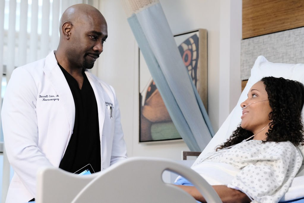 """Morris Chestnut and guest star Aisha Kabia in the """"Burn it All Down"""" season finale episode of """"The Resident""""   Photo: Getty Images"""