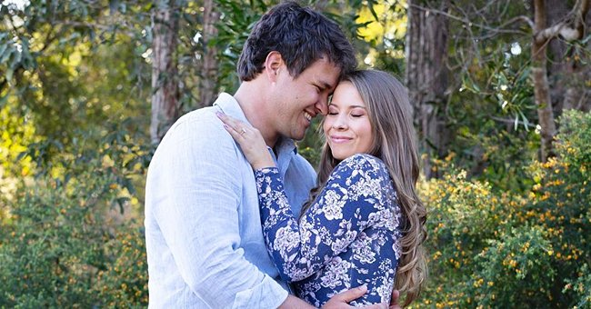 Bindi Irwin Holds Parrot Tenderly as She Poses with Her Growing Baby Bump in Baggy Plaid Shirt