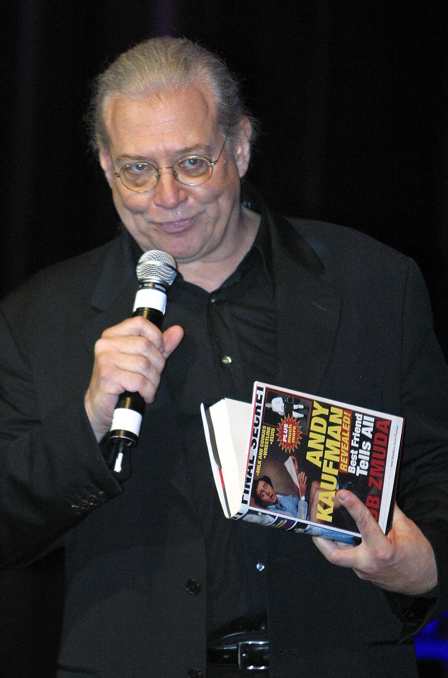 Zmuda holding is book at an event to celebrate the 20th anniversary of Kaufman's death, 2004, Los Angeles, California.     Photo: Getty Images
