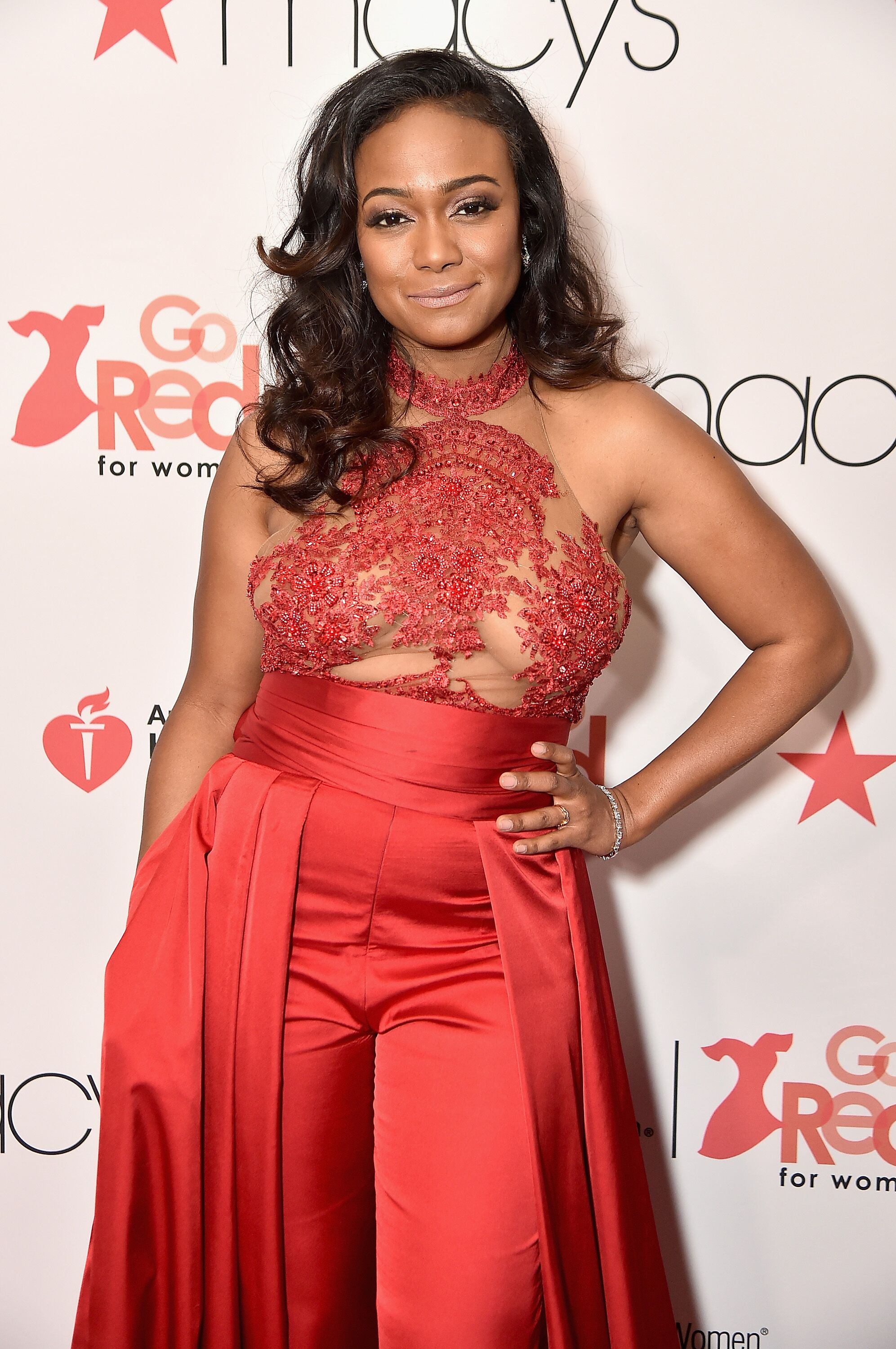 Tatyana Ali walkes the runway for the American Heart Association's Go Red For Women Red Dress Collection 2018| Source: Getty Images