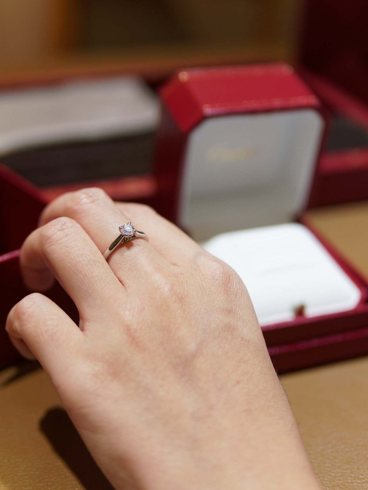 Photo of someone showing off ring   Photo: Pexels