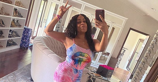 Niecy Nash Stuns Fans with Her Fit Figure Posing in Lavish Closet in a Rainbow-Colored Outfit