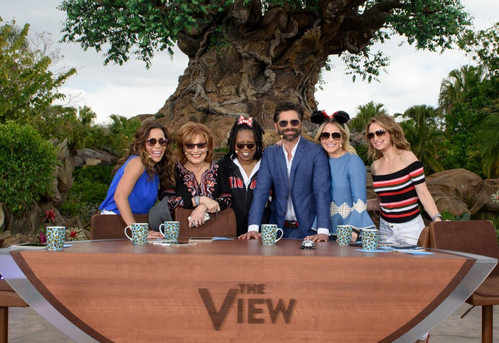 "Co-hosts of ""The View"" pose with Sara Haines, John Stamos and Jedediah Bila in Lake Buena Vista, Florida on March 6, 2017 