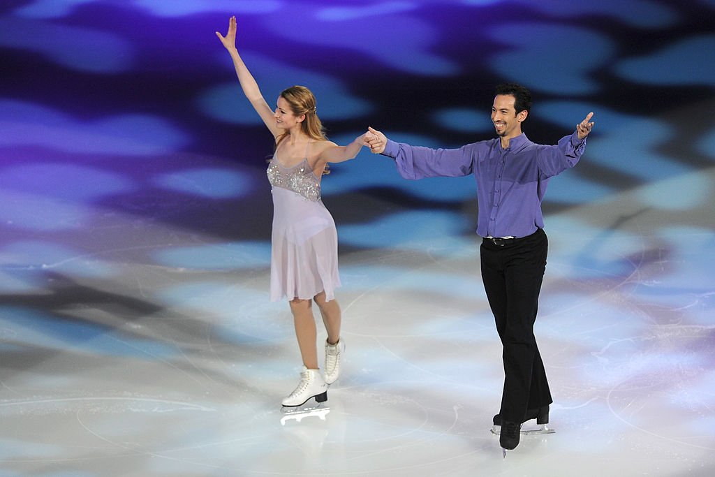 "Tanith Belbin and Ben Agosto skate together during the P&G & Wal-Mart ""Tribute to American Legends of the Ice"" at Izod Center on December 11, 2013 