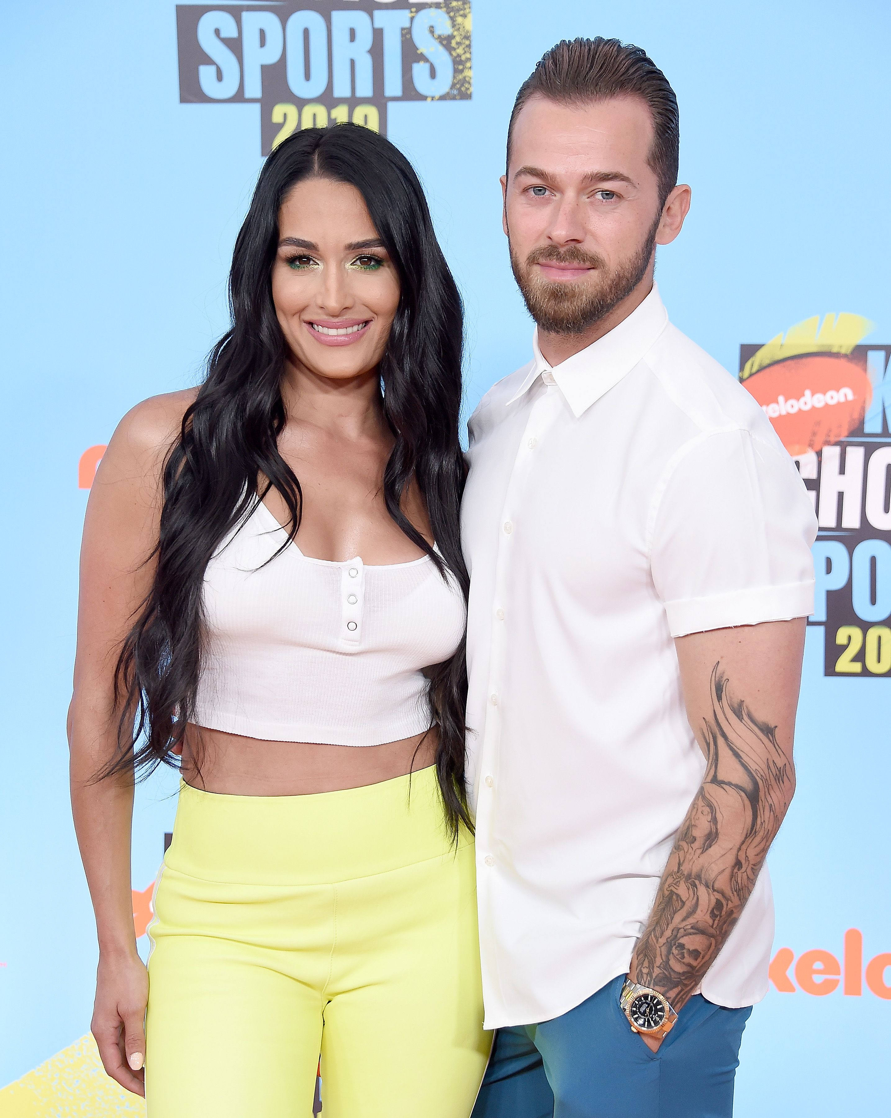 Nikki Bella and Artem Chigvintsev at the Nickelodeon Kids' Choice Sports event in 2019, in Santa Monica, California   Source: Getty Images