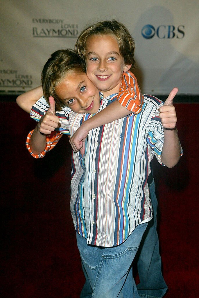 Actors Sullivan Sweeten (L) and Sawyer Sweeten attend the Everybody Loves Raymond Series Wrap Party  | Getty Images / Global Images Ukraine