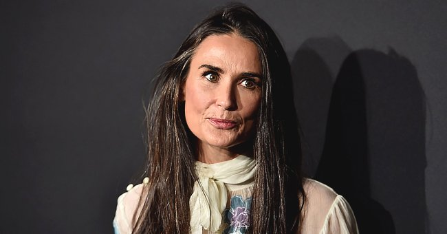 Demi Moore, 57, Looks Ageless as She Poses in Chic Eyeglasses and a White T-Shirt