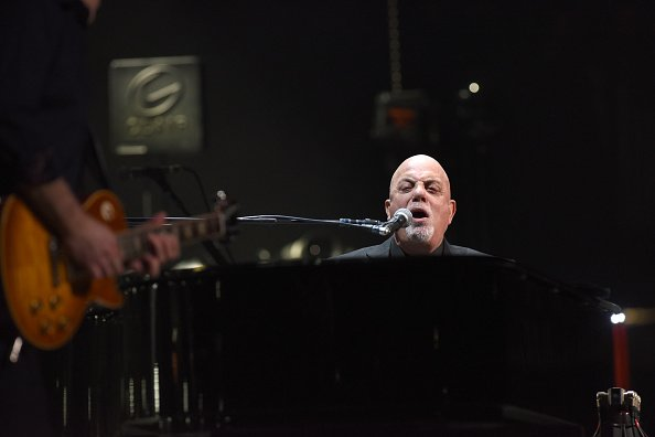 Billy Joel performing on stage at the Amway Center in Orlando, Florida. | Photo: Getty Images.