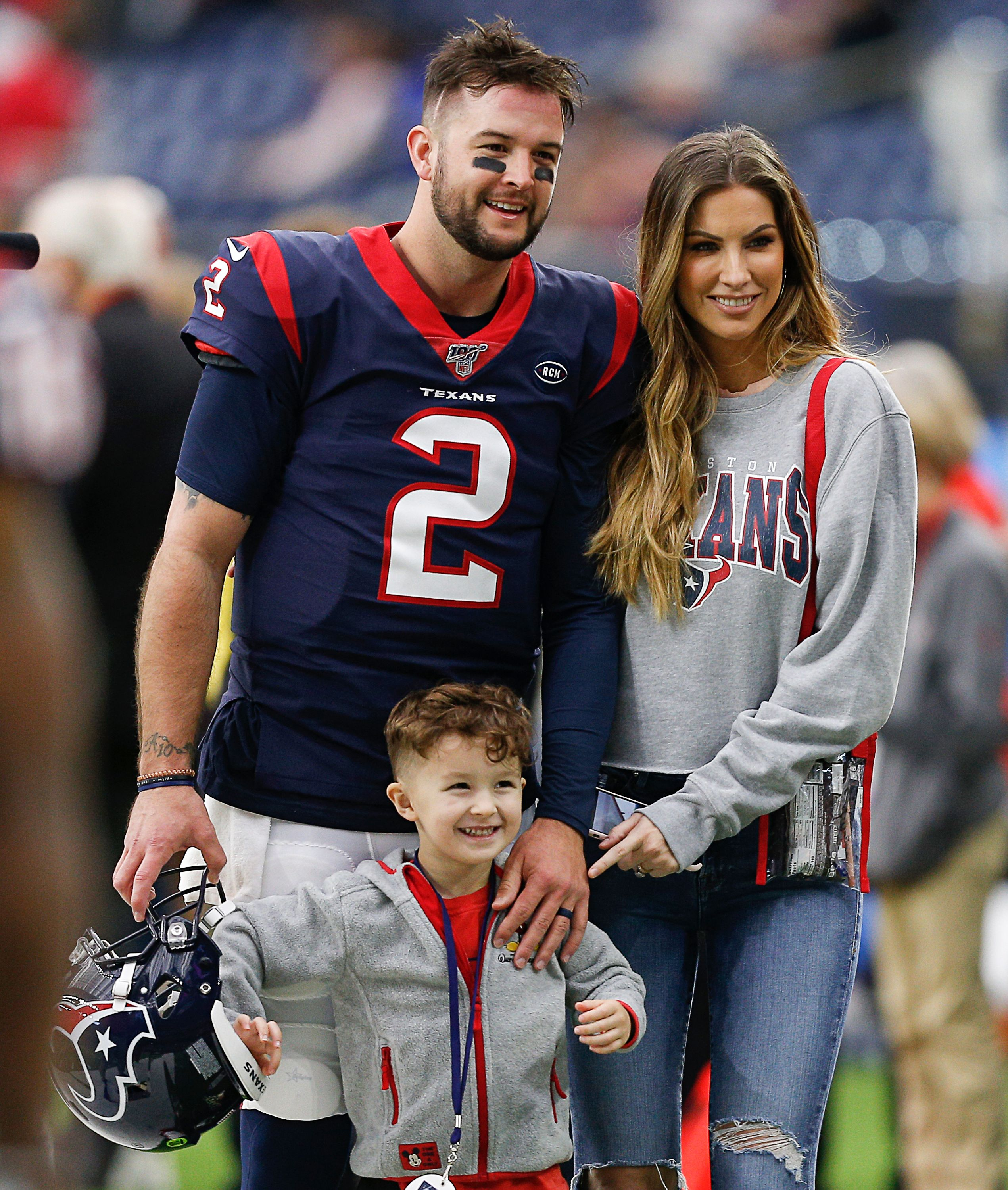AJ McCarron, his wife Katherine Webb-McCarron and their son Tripp at NRG Stadium in 2019 in Houston, Texas | Source: Getty Images
