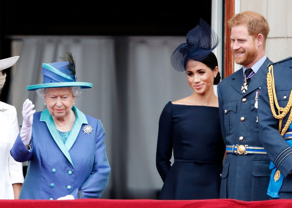 Queen Elizabeth and Meghan Markle stand on the balcony at Buckingham Palace as they watched a flypast marking the centenary of the Royal Air Force on July 10, 2018, in London, England. | Photo: Getty Images
