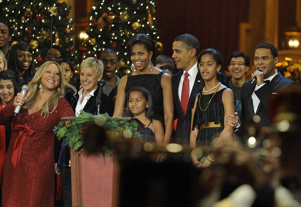 U.S. President Barack Obama and first lady Michelle Obama, with daughters Sasha and Malia, take part in the conclusion of a Christmas In Washington celebration   Getty Images