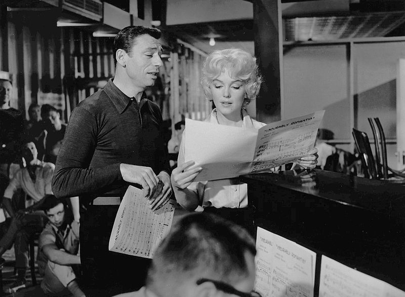 """French actor Yves Montand and Marilyn Monroe in the 1960 musical comedy """"Let's Make"""" 
