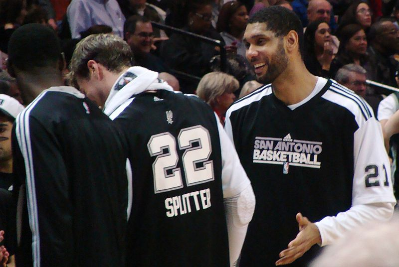 Tim Duncan courtside with San Antonio Spurs teammate DuncanTiago Splitter in 2010! Source: Wikimedia
