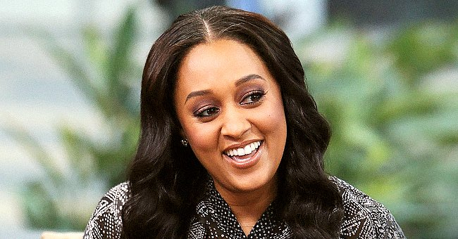 Tia Mowry Warms Hearts with Son Cree as They Plant Kisses on Baby Cairo While Holding Balloons