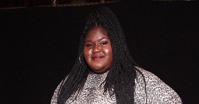 Gabby Sidibe Puts Her Legs on Display as She Swings on a Hammock in a Floral Mini Dress (Video)