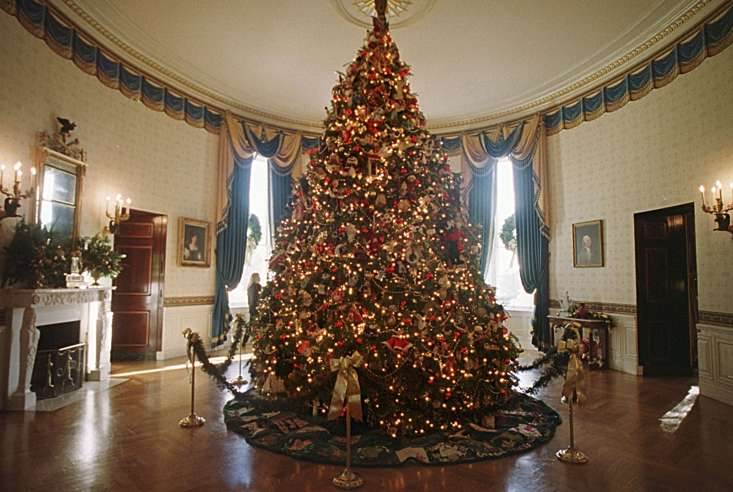 The White House Christmas tree in the Blue Room of the White House December 4, 2000 in Washington DC. | Source: Getty Images
