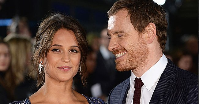 A portrait of Alicia Vikander and her husband Michael Fassbender smiling   Photo: Getty Images