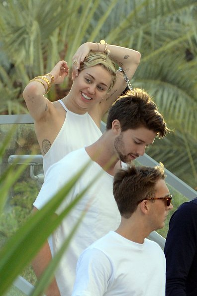 Cody Simpson, Patrick Schwarzenegger and Miley Cyrus are sighted at La Cote in the Fontainebleau Miami Beach Florida | Photo: Getty Images
