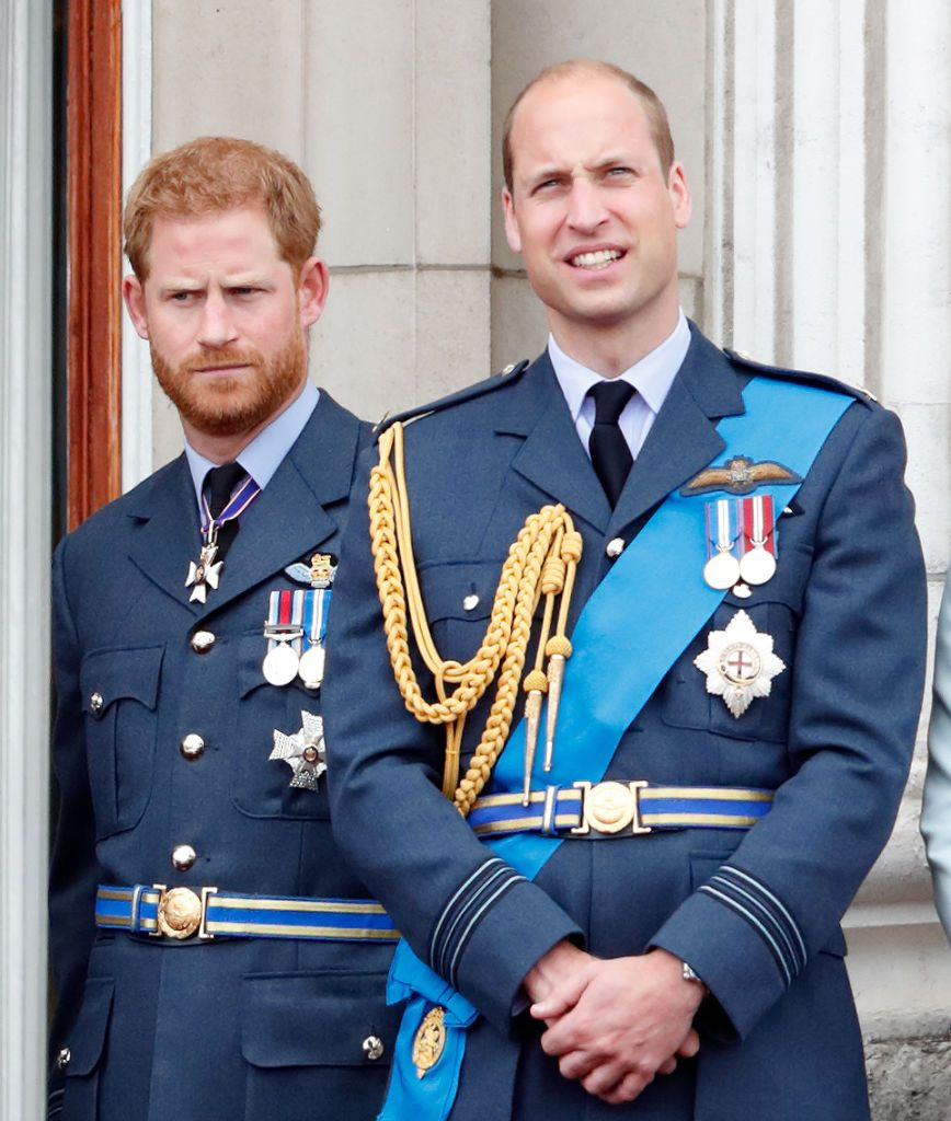 Prince Harry and Prince William watch a flypast to mark the centenary of the Royal Air Force from the balcony of Buckingham Palace on July 10, 2018, in London, England | Photo: Getty Images