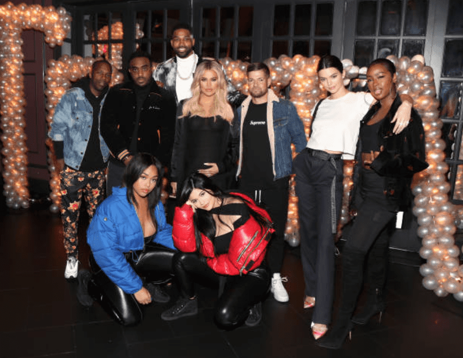 During Remy Martin birthday celebration for Tristan Thompson, he posed with Rich Paul, Simon, Khloe Kardashian, Lucas Newton, Kendall Jenner, Justine Skye, Jordan Woods, and Kylie Jenner at Beauty & Essex on March 10, 2018m in Los Angeles, California | Source Jerritt Clark/Getty Images for Remy Martin