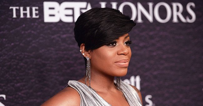 Fantasia from 'American Idol' Flaunts Ankle Tattoos Posing near Waterfall in Skin-Tight Outfit