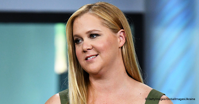 Amy Schumer Shares Sweet Selfie with Sleeping Newborn Son Wrapped in an Animal Print Blanket