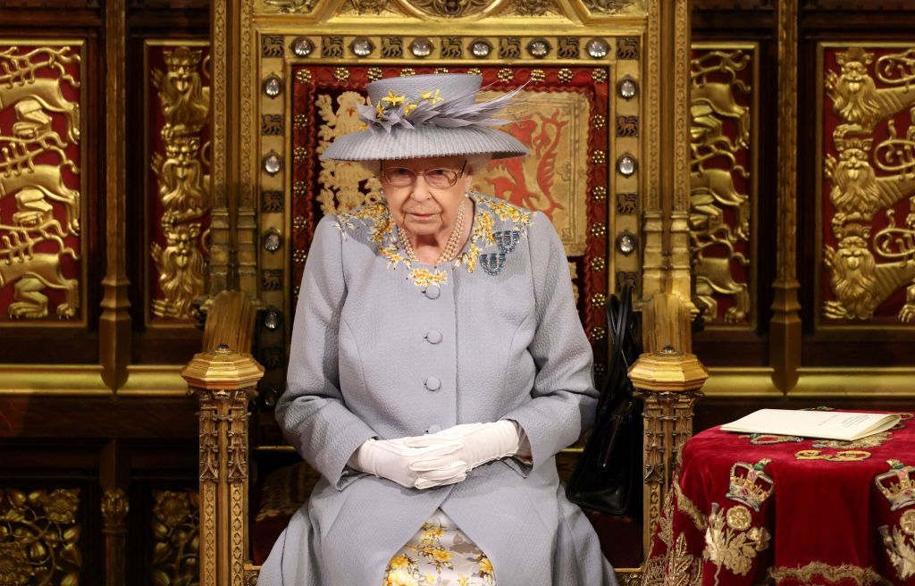 Queen Elizabeth II sits on the The Sovereign's Throne in the House of Lords chamber during the State Opening of Parliament at the Houses of Parliament in London on May 11, 2021 | Getty Images