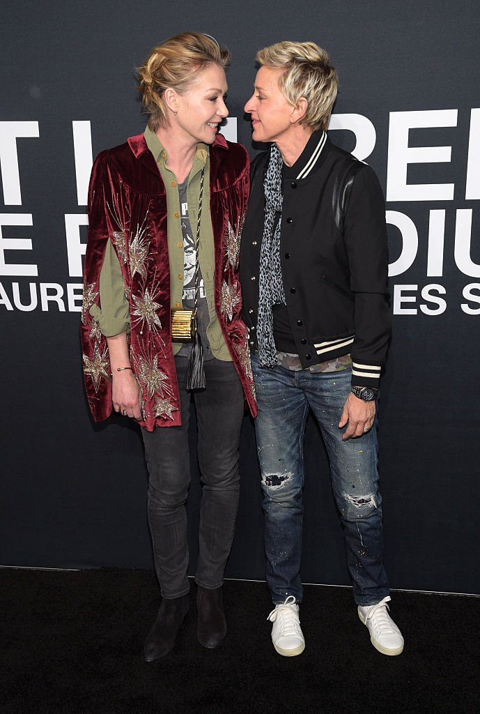 Portia De Rossi and Ellen DeGeneres attend the Saint Laurent show on February 10, 2016 in Los Angeles, California. | Source: Getty Images.