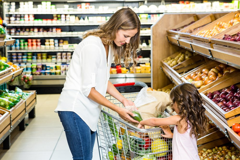 A photo of a mother and daughter going grocery shopping. | Photo: Shutterstock