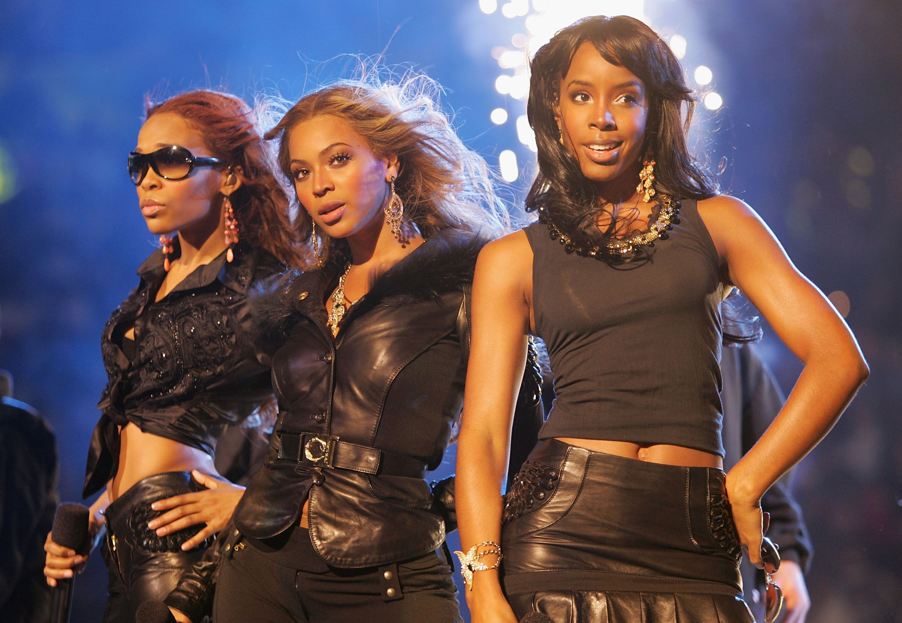 Kelly Rowland, Beyoncé Knowles and Michelle Williams performing as Destiny's Child at the 2005 NBA All Star Game in Denver, Colorado | Source: Getty Images